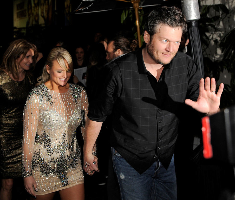 Description of . Country singers Blake Shelton and his wife, Miranda Lambert, arrive at the Warner Music Group 2013 Grammy Celebration at the Chateau Marmont, Sunday, Feb. 10, 2013, in West Hollywood, Calif. (Photo by Chris Pizzello/Invision/AP)