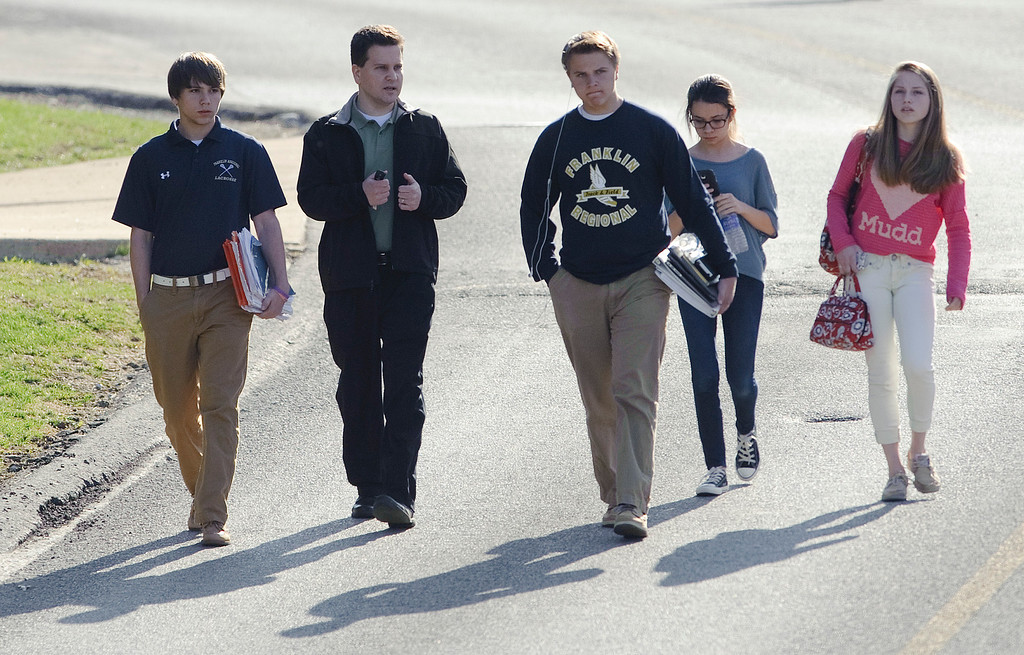 Description of . Students and a guardian walk to their car from Franklin Regional Middle School after more then a dozen students were stabbed by a knife wielding suspect at nearby Franklin Regional High School on Wednesday, April 9, 2014, in Murrysville, Pa., near Pittsburgh. The suspect, a male student, was taken into custody and is being questioned. (AP Photo/Tribune Review, Brian F. Henry)