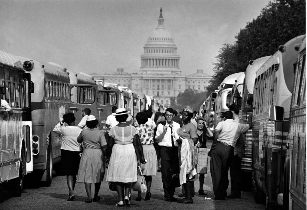 Description of . With the U.S. Capitol in the background, passengers for charter busses walk along a service roadway of the Mall in Washington, August 28, 1963, to find their transportation home after a civil rights demonstration estimated by police at more than 200,000 people.  (AP Photo)