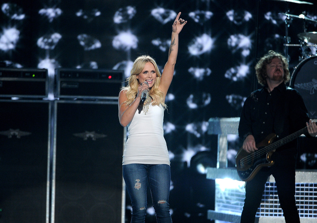 Description of . FILE - In this April 6, 2014 file photo, Miranda Lambert performs on stage at the 49th annual Academy of Country Music Awards at the MGM Grand Garden Arena, in Las Vegas. Lambert leads the 2014 CMT Music Awards with six nominations. The show airs live from Nashville's Bridgestone Arena on Wednesday, June 4, 2014 at 8 p.m. ET. (Photo by Chris Pizzello/Invision/AP, file)