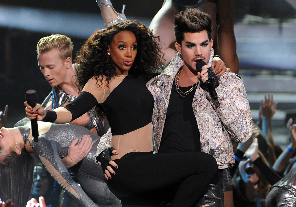 Description of . LOS ANGELES, CA - DECEMBER 16:  (L-R) Singers Kelly Rowland and Adam Lambert perform onstage during