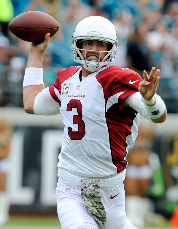 Description of . Arizona Cardinals quarterback Carson Palmer (3) throws a pass as he is pressured by the Jacksonville Jaguars defense during the first half of an NFL football game in Jacksonville, Fla., Sunday, Nov. 17, 2013. (AP Photo/Stephen Morton)