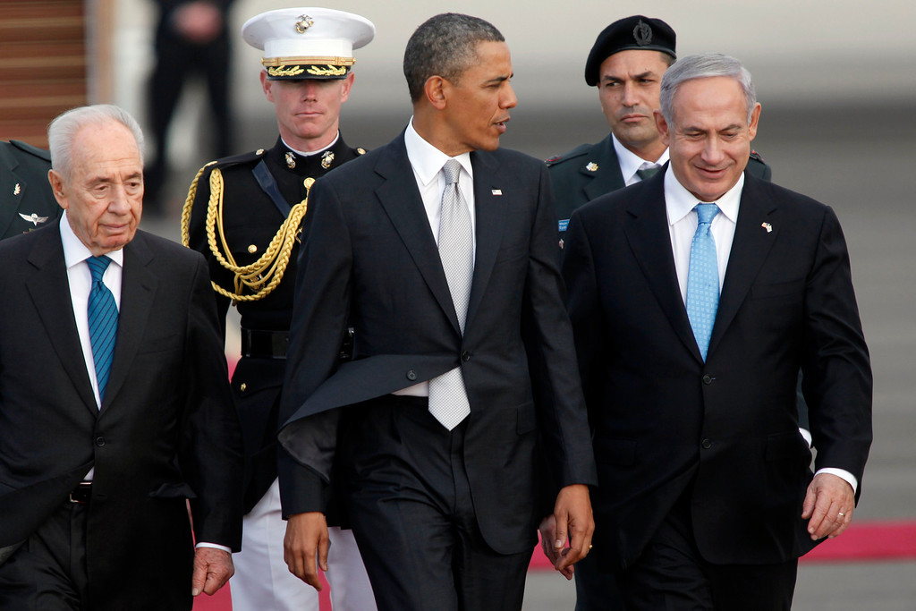 Description of . Israeli President Shimon Peres, U.S. President Barack Obama, Israeli Prime Minister Benjamin Netanyahu walk together prior to Obama departing from Ben Gurion International Airport on March 22, 2013 in Lod' Israel. Obama concluded his first visit to Israel and West Bank after three-days of meetings with Israeli and Palestinian leaders.  (Photo by Lior Mizrahi/Getty Images)