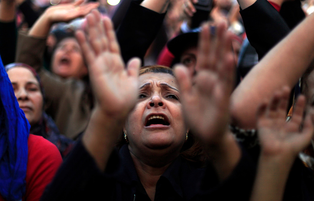 Description of . Egyptian protesters chant slogans at rally in Tahrir Square in Cairo, Egypt, Tuesday, Nov. 27, 2012. Egyptians flocked to Cairo's central Tahrir square on Tuesday for a protest against Egypt's president in a significant test of whether the opposition can rally the street behind it in a confrontation aimed at forcing the Islamist leader to rescind decrees that granted him near absolute powers. (AP Photo/ Khalil Hamra)