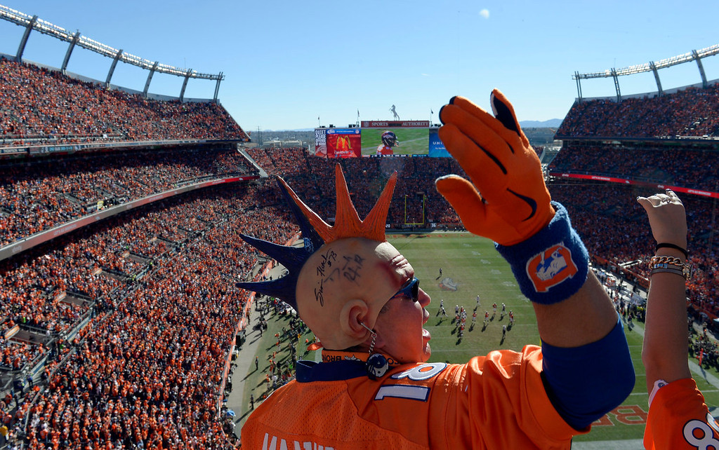 Description of . Rubin Martinez cheers on the Broncos during the first half.  The Denver Broncos vs. The New England Patriots in an AFC Championship game  at Sports Authority Field at Mile High in Denver on January 19, 2014. (Photo by Craig Walker/The Denver Post)