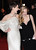 Actresses Anne Hathaway and Amanda Seyfriend attend the