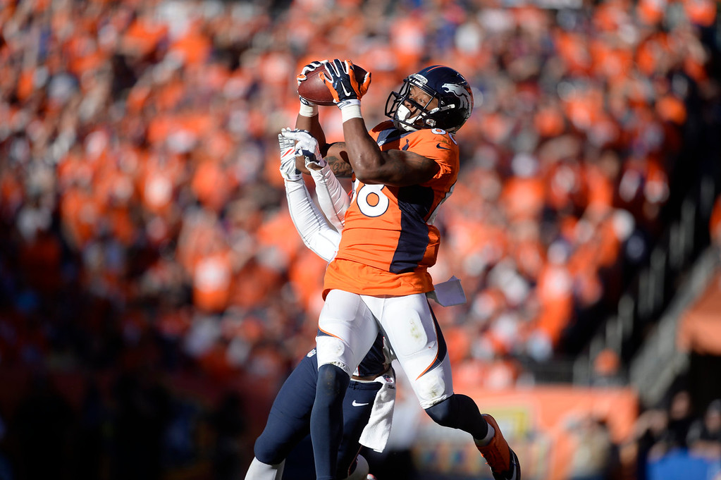 Description of . Denver Broncos wide receiver Demaryius Thomas (88) makes a catch in the third quarter. The Denver Broncos take on the New England Patriots in the AFC Championship game at Sports Authority Field at Mile High in Denver on January 19, 2014. (Photo by AAron Ontiveroz/The Denver Post)