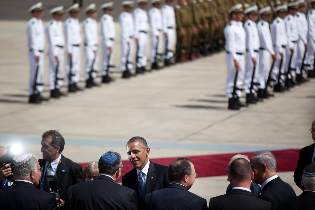 Description of . US President Barack Obama talks to officials during a welcoming ceremony on his arrival at Ben Gurion International Airport on March, 20, 2013 near Tel Aviv, Israel. (Photo by Uriel Sinai/Getty Images)