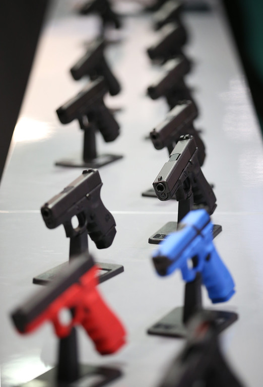 Description of . Glock pistols are displayed at the Defense and Security Exhibition on September 10, 2013 in London, England.   (Photo by Peter Macdiarmid/Getty Images)