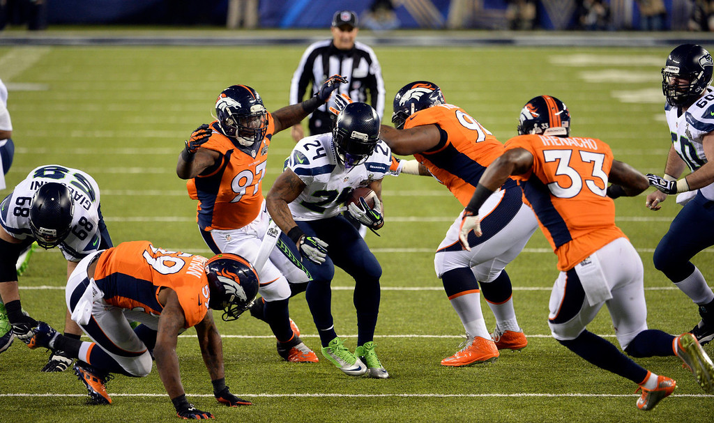 Description of . Seattle Seahawks running back Marshawn Lynch (24) rushes for a first down during the second quarter.  The Denver Broncos vs the Seattle Seahawks in Super Bowl XLVIII at MetLife Stadium in East Rutherford, New Jersey Sunday, February 2, 2014. (Photo by Hyoung Chang//The Denver Post)