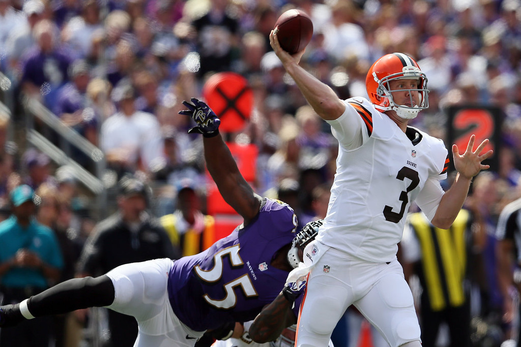 Description of . Quarterback Brandon Weeden #3 of the Cleveland Browns throws a pass while being pressured by outside linebacker Terrell Suggs #55 of the Baltimore Ravens during the first half at M&T Bank Stadium on September 15, 2013 in Baltimore, Maryland.  (Photo by Rob Carr/Getty Images)