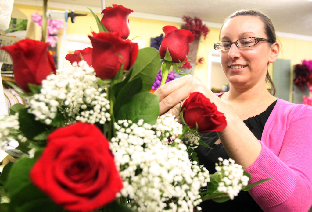 . Thode\'s Floral and Gift Shop floral designer Jessica Granger works on a Valentine\'s Day arrangement Thursday Feb. 14, 2013 in LaPorte, Ind.  (AP Photo/The LaPorte Herald-Argus,Bob Wellinski )