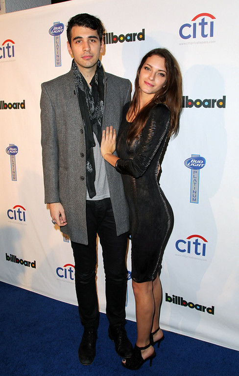 Description of . Nick Simmons (L) and Jessica Marie attend the 2nd Annual Billboard Grammys After-Party at The London Hotel on January 26, 2014 in West Hollywood, California.  (Photo by David Buchan/Getty Images)