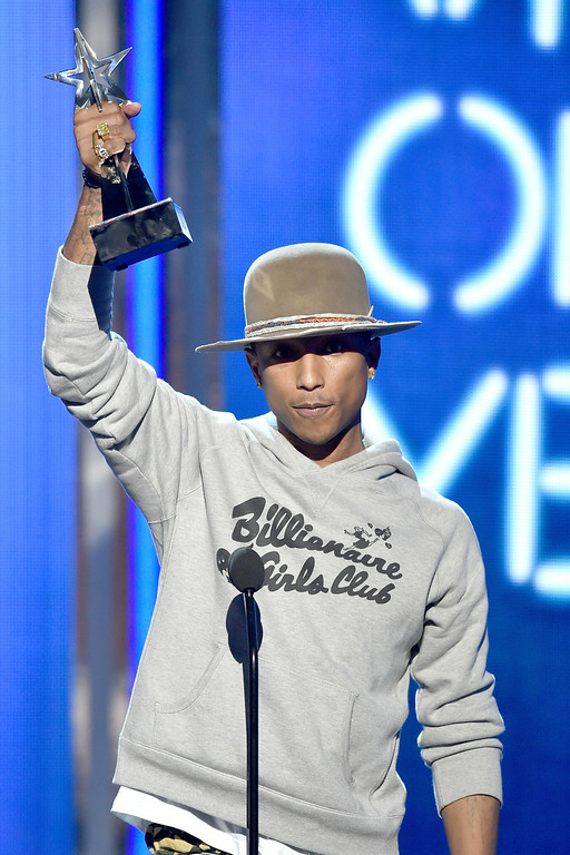 Description of . Singer Pharrell Williams accepts Video of the Year for 'Happy' onstage during the BET AWARDS '14 at Nokia Theatre L.A. LIVE on June 29, 2014 in Los Angeles, California.  (Photo by Kevin Winter/Getty Images for BET)