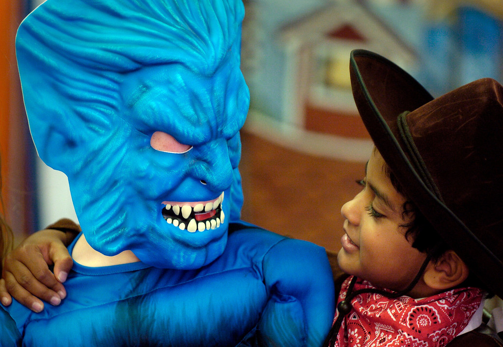 Description of . Kindergartners, Christian Backes, 6-years-old, left, and Nagarjuna Gowda, 5-years-old, get a look at each other's costumes before heading out for their  Halloween parade through the halls of Steck Elementary School Tuesday afternoon, October 2006. THE DENVER POST/ ANDY CROSS