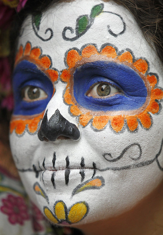 Description of . Kamil del Toro is dressed as a Day of the Dead sugar skull for Mardi Gras in the French Quarter. Fat Tuesday, the traditional celebration on the day before Ash Wednesday and the begining of Lent, is marked in New Orleans with parades and marches through many neighborhoods in the city. (Photo by Rusty Costanza/Getty Images)