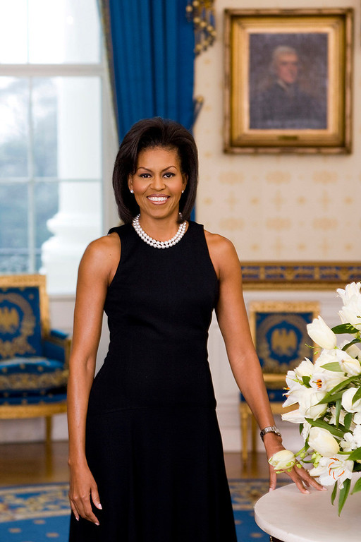 Description of . **FILE**    This February 2009 file photo released by The White House on Feb. 27, 2009, shows the official portrait of first lady Michelle Obama taken in the Blue Room of The White House in Washington.  (AP Photo/The White House, Joyce N. Boghosian, File)