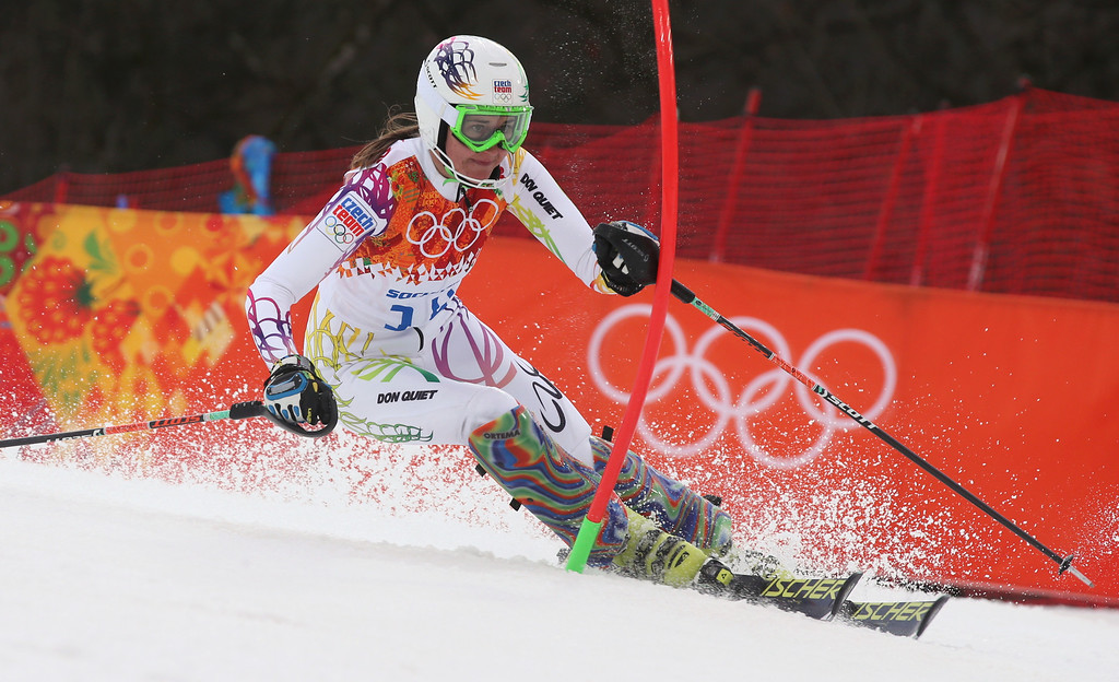 Description of . Czech Republic's Sarka Strachova skis past a gate in the first run of the women's slalom at the Sochi 2014 Winter Olympics, Friday, Feb. 21, 2014, in Krasnaya Polyana, Russia. (AP Photo/Luca Bruno)