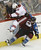 DENVER, CO. - FEBRUARY 11: Greg Zanon (4) of the Colorado Avalanche collides with Antoine Vermette (50) of the Phoenix Coyotes along the boards during the second period February 11, 2013 at Pepsi Center.(Photo By John Leyba/The Denver Post)