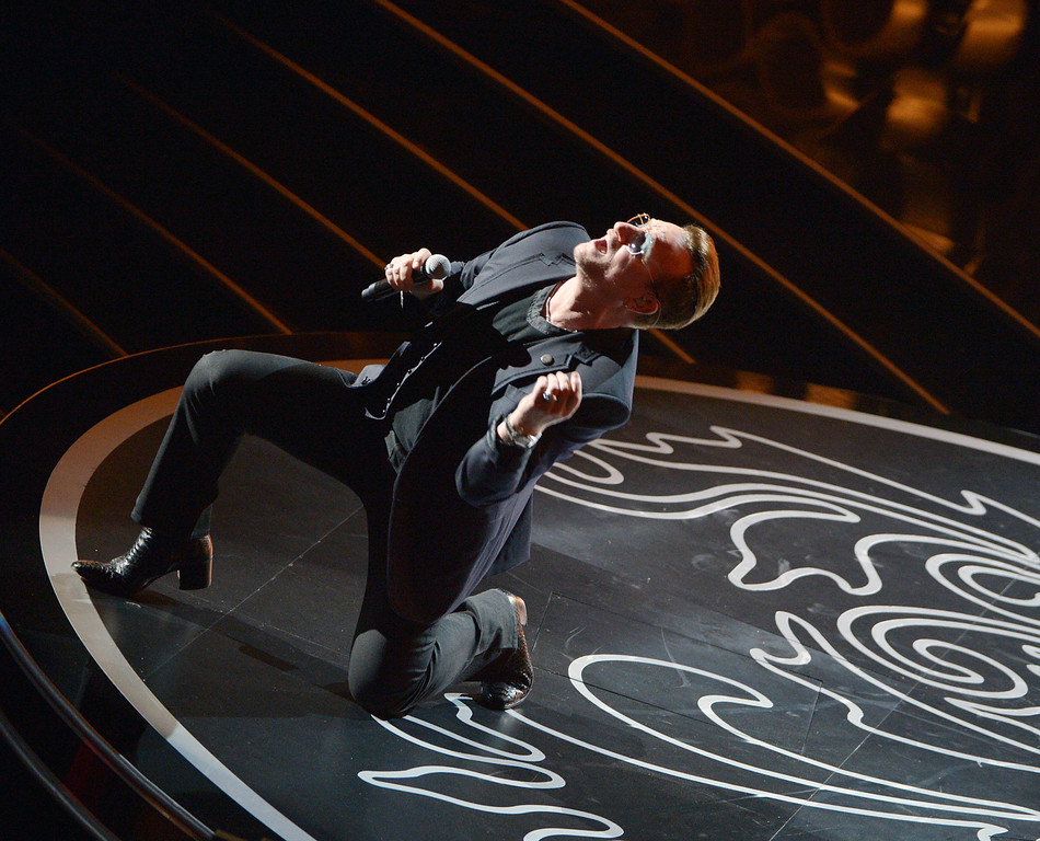 Description of . Bono of U2 performs during the Oscars at the Dolby Theatre on Sunday, March 2, 2014, in Los Angeles.  (Photo by John Shearer/Invision/AP)