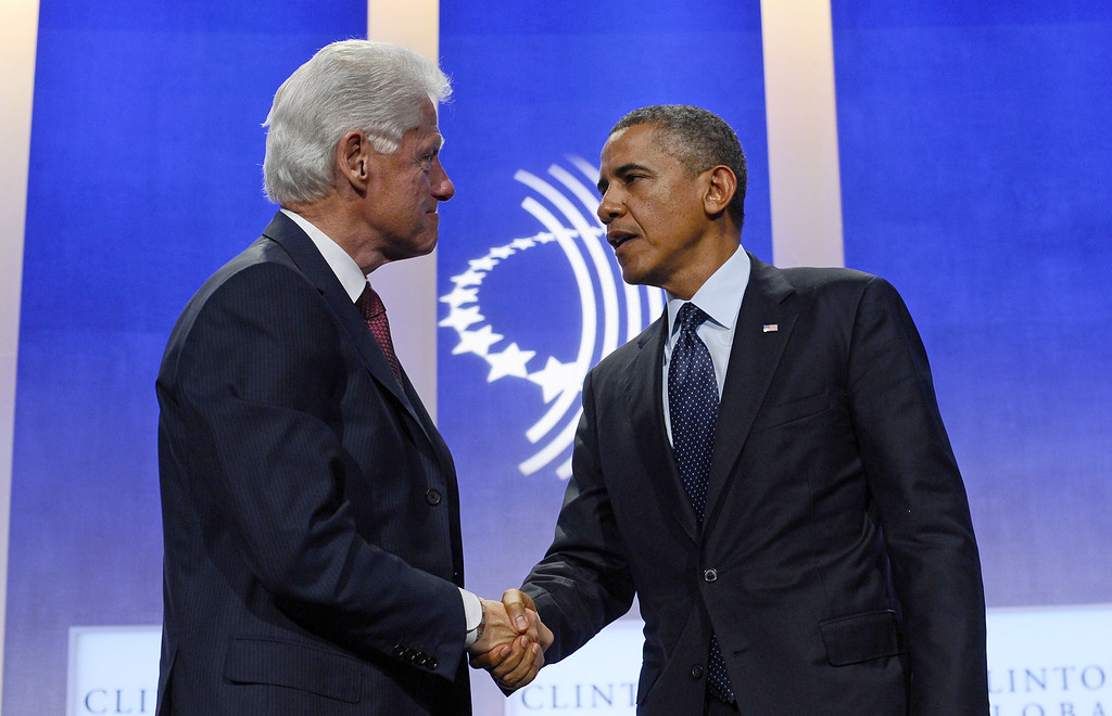 . US President Barack Obama shakes hands with former president Bill Clinton after participating in a conversation about the future of health care reform in America, and the benefits of expanding access to quality health care around the globe at Clinton Global Initiative in New York on September 24, 2013. JEWEL SAMAD/AFP/Getty Images