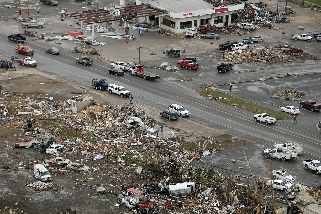 Description of . Homes and businesses are wrecked in downton Vilonia, Ark., Monday, April 28, 2014 after a tornado struck the town late Sunday. The most powerful twister this year carved an 80-mile path of destruction through suburbs north of the state capital of Little Rock, killing at least 16 people. (AP Photo/Danny Johnston)