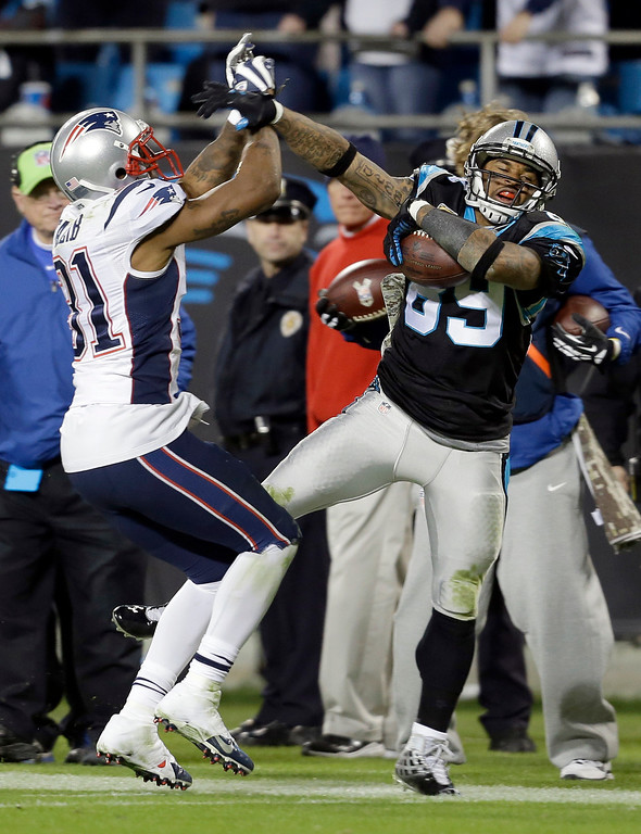 . Carolina Panthers\' Steve Smith (89) is knocked out of bounds by New England Patriots\' Aqib Talib (31) during the second half of an NFL football game in Charlotte, N.C., Monday, Nov. 18, 2013. (AP Photo/Gerry Broome)