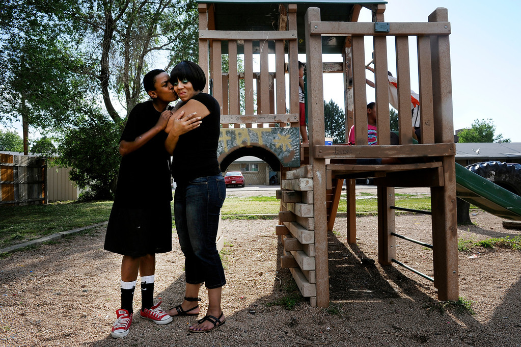 "Description of . Isaiah Marquez, 14, kisses his mother Danita Johnson outside their home in Aurora. Johnson is determined to keep her family together and offer her children a better life. ""I've worked hard and they're home, so it's time to move forward,"" she said.  ""I'm not whole unless I have my kids."" Craig F. Walker, The Denver Post"