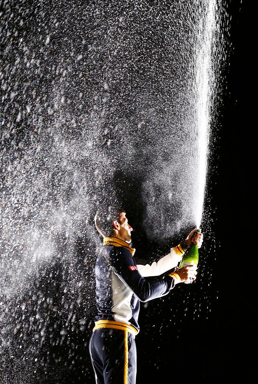 . Novak Djokovic of Serbia sprays a sparkling beverage after defeating Andy Murray of Britain in their men\'s singles final match at the Australian Open tennis tournament in Melbourne, January 27, 2013. REUTERS/Tim Wimborne