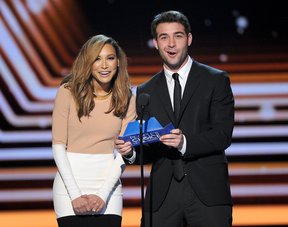 Description of . LOS ANGELES, CA - JANUARY 08:  Actors Naya Rivera (L) and James Wolk speak onstage at The 40th Annual People's Choice Awards at Nokia Theatre L.A. Live on January 8, 2014 in Los Angeles, California.  (Photo by Kevin Winter/Getty Images)