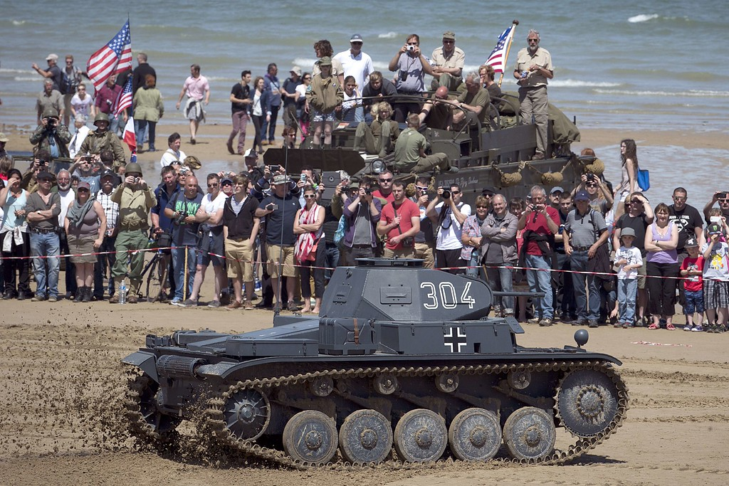Description of . People look at a German Panzer II tank used in World War II on the Arromanches beach, Normandy, on June 6, 2014 during the ceremonies marking the 70th anniversary of the Operation Overlord.    AFP PHOTO / JOEL SAGET/AFP/Getty Images
