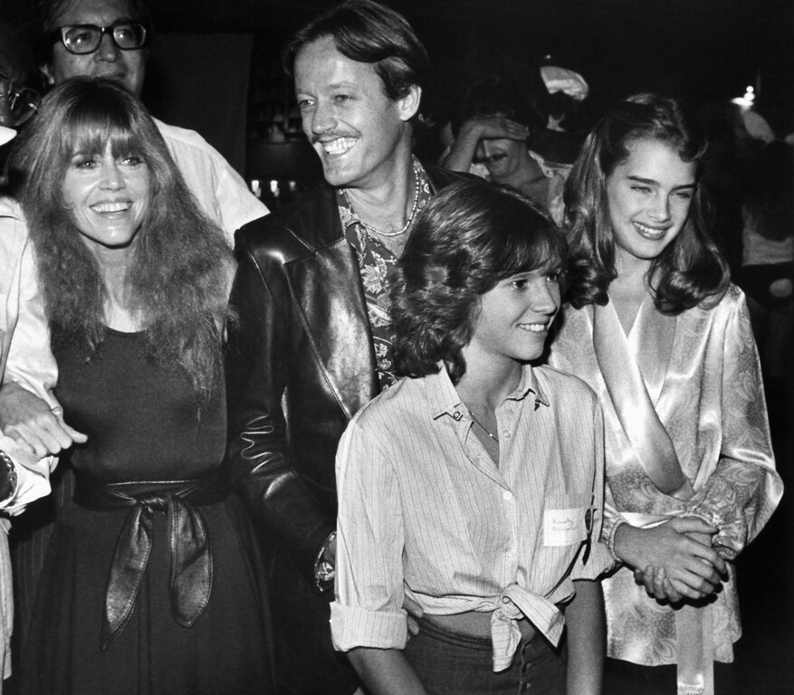 Description of . Jane and Peter Fonda, Kristy McNichol and Brooke Shields, from left, arrive at a Halloween Celebrity Disco Dance benefit in Los Angeles\, Nov. 1, 1978. Unlike most of the approximately 1,000 guests, who came for the most part in costume, they and the other celebrities attending wore civilian clothes. Event was on behalf of Campaign for Economic Democracy, an organization promoting solar energy, headed by Ms. Fonda. (AP Photo/Reed Saxon)