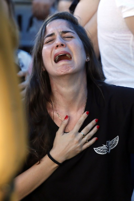 Description of . A relative of 21-year-old Israeli St.-Sgt. Matan Gotlib, mourns during his funeral at the military cemetery in the Israeli costal city of Rishon Letzion on July 31, 2014, after he was killed the previous day in combat in the Gaza Strip. Israel said it would not pull troops from Gaza until they finish destroying a network of cross-border tunnels, and the army confirmed mobilising another 16,000 additional reservists, hiking the total number called up to 86,000. AFP PHOTO/ GALI TIBBON/AFP/Getty Images