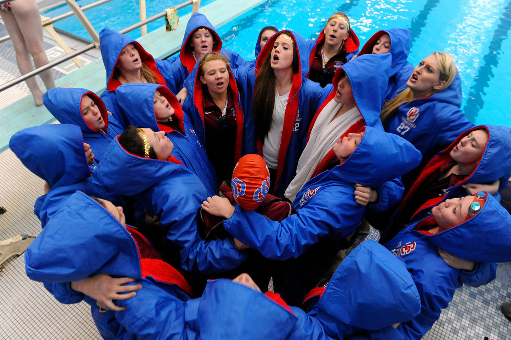 Description of . Cherry Creek swimmers gathered for a group yell before the meet Saturday. The Colorado High School Girls 5A State Swim Championships wrapped up Saturday, February 11, 2012 in Fort Collins. Karl Gehring/The Denver Post