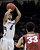 University of Colorado's Askia Booker takes a shot in front of Dwight Powell during a game against Stanford on Thursday, Jan. 24, at the Coors Event Center on the CU campus in Boulder. Jeremy Papasso/ Camera