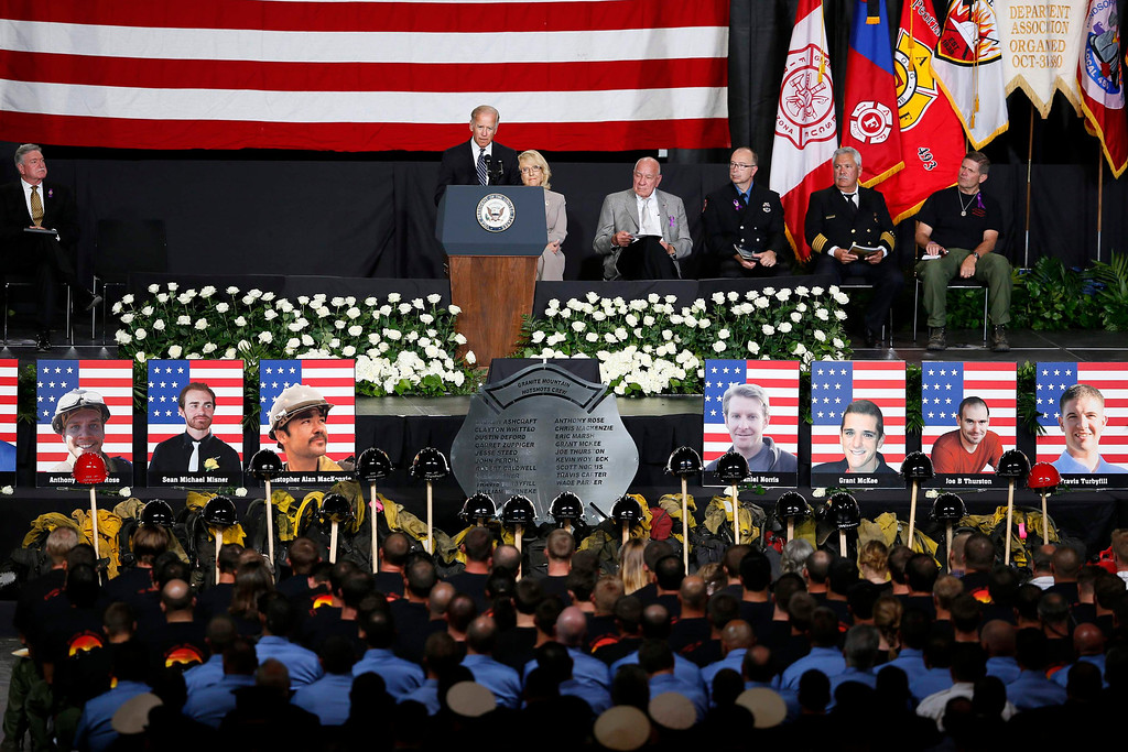 Description of . U.S. Vice President Joe Biden speaks at a memorial service for the fallen members of the Granite Mountain Hotshots, in Prescott Valley, Arizona July 9, 2013. Thousands of mourners, including firefighters from around the country and Biden, converged in central Arizona on Tuesday to pay final tribute to 19 young firemen killed last week in the line of duty. REUTERS/Lucy Nicholson