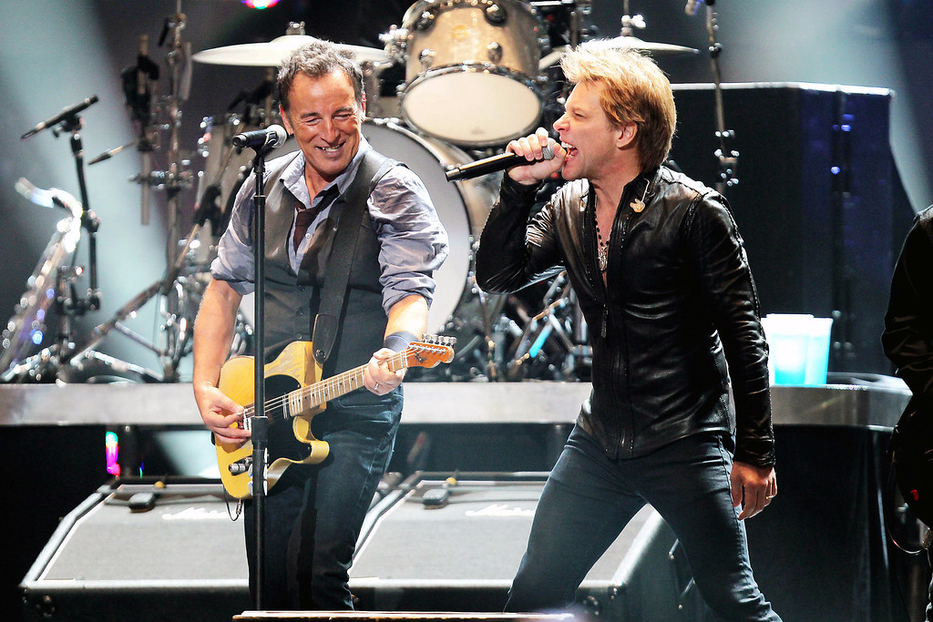 Description of . This image released by Starpix shows Bruce Springsteen, left, and Jon Bon Jovi performing at the 12-12-12 The Concert for Sandy Relief at Madison Square Garden in New York on Wednesday, Dec. 12, 2012. Proceeds from the show will be distributed through the Robin Hood Foundation. (AP Photo/Starpix, Dave Allocca)