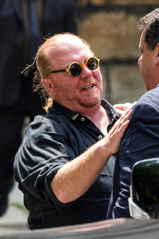 Description of . Chef Mario Batali leaves after attending the funeral for Actor James Gandolfini at The Cathedral Church of St. John the Divine on June 27, 2013 in New York City.   (Photo by Andrew Burton/Getty Images)