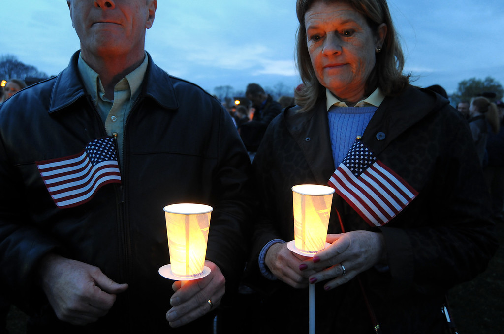Description of . Tom and Nancy Gallagher attend a vigil ceremony  April 16, 2013 in Dorcester, Massachusetts honoring the Richard family, who's 8-year-old son Martin was killed,  sister Jane, who lost a leg, and mother Denise, who was also seriously injured when bombs exploded at the finish of the Boston Marathon April 15th.   JOHN MOTTERN/AFP/Getty Images