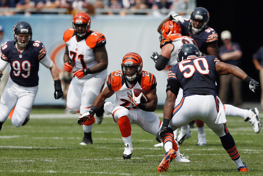 Description of . Cincinnati Bengals running back Giovani Bernard (25) rushes against Chicago Bears linebacker James Anderson (50) during the first half of an NFL football game, Sunday, Sept. 8, 2013, in Chicago. (AP Photo/Charles Rex Arbogast)