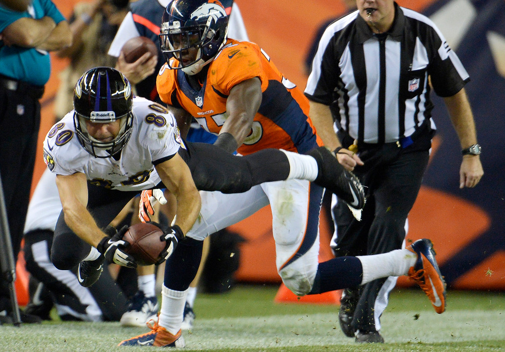 Description of . Baltimore Ravens wide receiver Brandon Stokley (80) reaches for extra yards trying for the first downDenver Broncos Baltimore Ravens September 5, 2013 at Sports Authority at Mile High. (Photo by Joe Amon/The Denver Post)