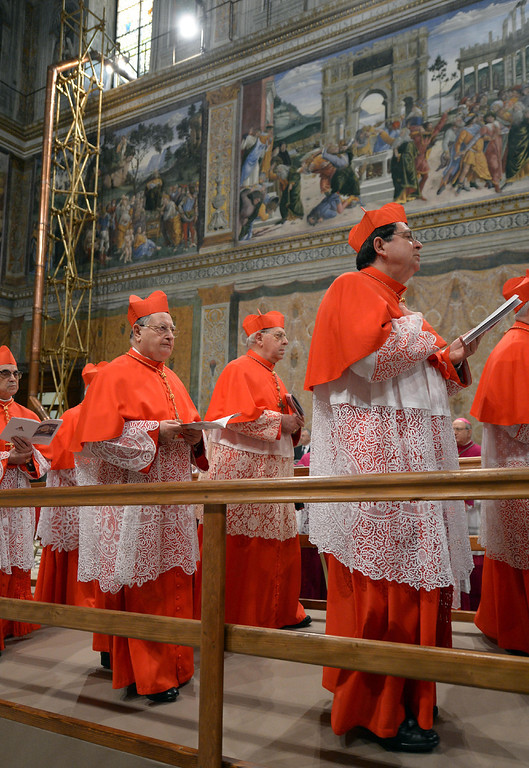 "Description of . This handout picture released by the Press office shows cardinals arriving at the Sistine Chapel with the chimney in the background before the start of the conclave at the Vatican on March 12, 2013. �AFP PHOTO/OSSERVATORE ROMANO""-/AFP/Getty Images"