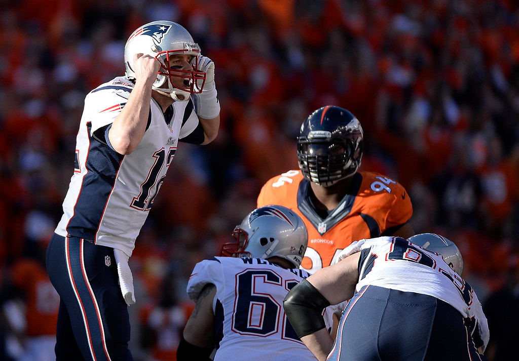Description of . New England Patriots quarterback Tom Brady (12) yells a play at the line in the third quarter. The Denver Broncos take on the New England Patriots in the AFC Championship game at Sports Authority Field at Mile High in Denver on January 19, 2014. (Photo by AAron Ontiveroz/The Denver Post)