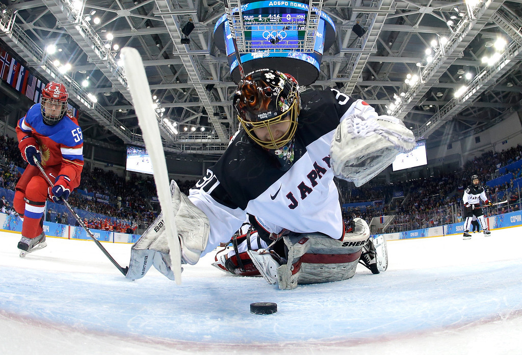 Description of . Nana Fujimoto #30 of Japan makes a save  against Russia during the Women\'s Ice Hockey Preliminary Round Group B game on day four of the Sochi 2014 Winter Olympics at Shayba Arena on February 11, 2014 in Sochi, Russia.  (Photo by Mark Blinch - Pool/Getty Images)