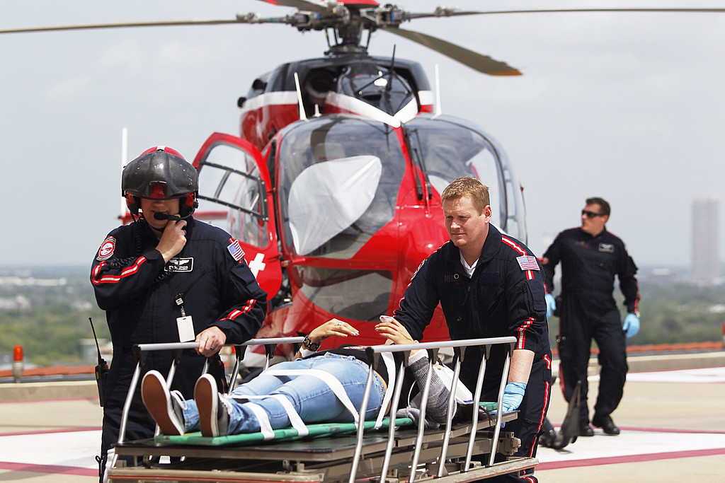 Description of . Life Flight personnel rush a victim wounded in a stabbing attack on the Lone Star community college system's Cypress, Texas campus into Memorial Hermann Hospital Tuesday, April 9, 2013, in Houston. (AP Photo/Houston Chronicle, Johnny Hanson)