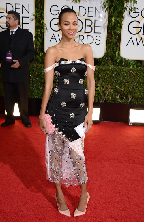 Description of . Zoe Saldana arrives at the 71st annual Golden Globe Awards at the Beverly Hilton Hotel on Sunday, Jan. 12, 2014, in Beverly Hills, Calif. (Photo by Jordan Strauss/Invision/AP)