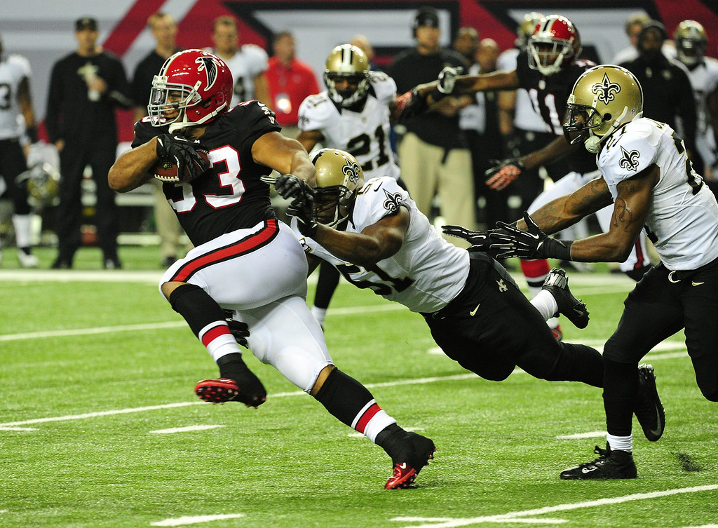 Description of . ATLANTA, GA - NOVEMBER 18:  Michael Turner #33 of the Atlanta Falcons carries the ball against Jonathan Vilma #41 of the New Orleans Saints at the Georgia Dome on November 29, 2012 in Atlanta, Georgia  (Photo by Scott Cunningham/Getty Images)