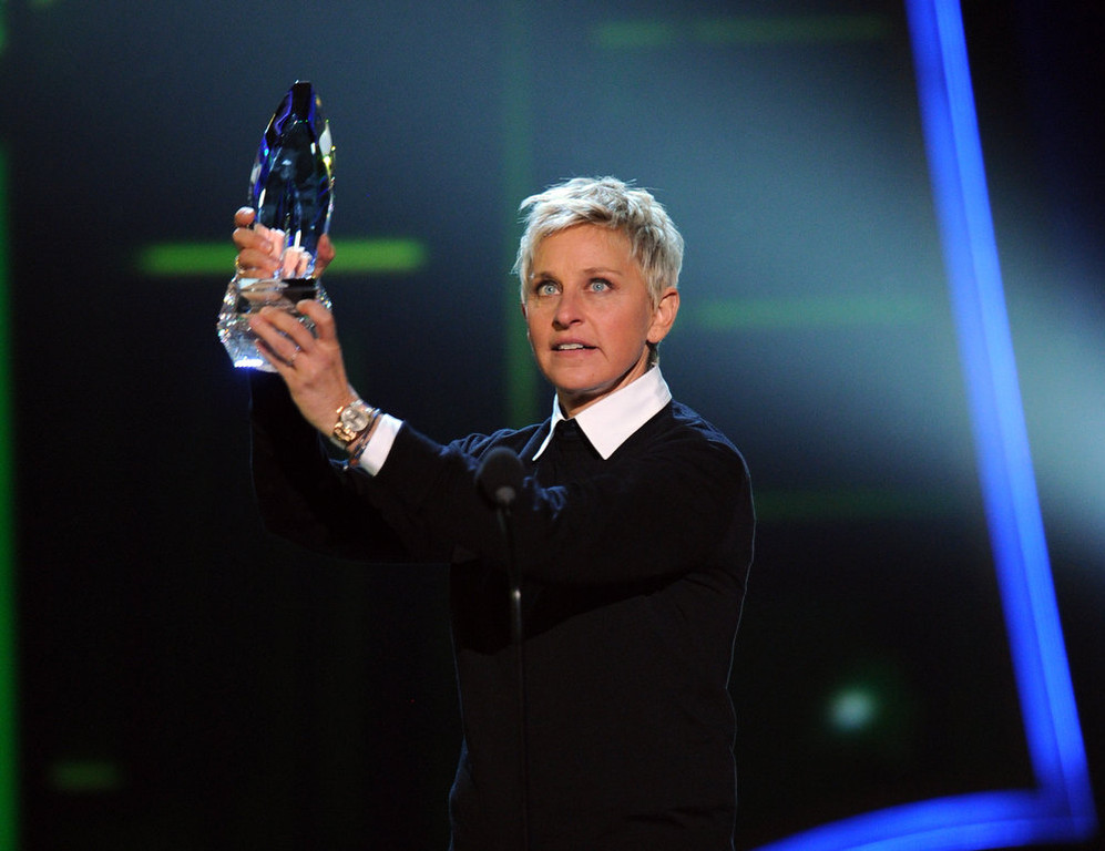 Description of . TV personality Ellen DeGeneres, winner of Favorite Daytime TV Host, speaks onstage at the 39th Annual People's Choice Awards  at Nokia Theatre L.A. Live on January 9, 2013 in Los Angeles, California.  (Photo by Kevin Winter/Getty Images for PCA)