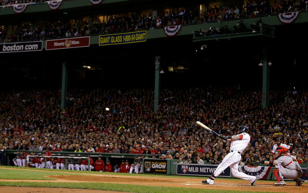Description of . Boston Red Sox's Mike Napoli hits a three-run double during the first inning of Game 1 of baseball's World Series against the St. Louis Cardinals Wednesday, Oct. 23, 2013, in Boston. (AP Photo/Matt Slocum)