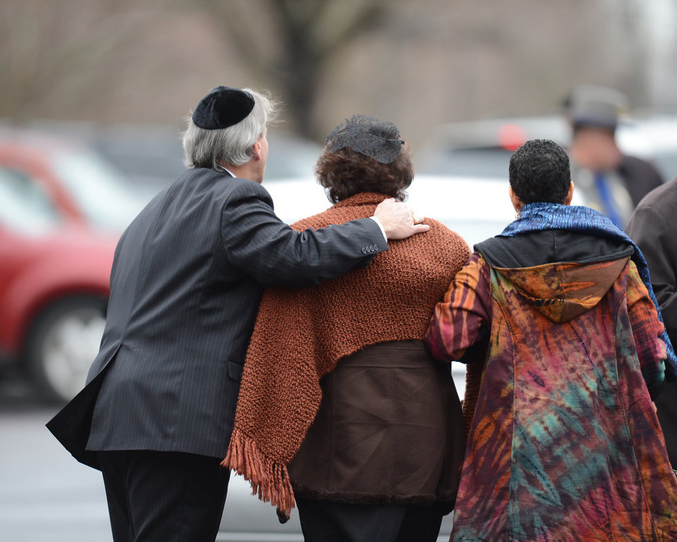 . Veronika Pozner(C), mother of Noah Pozner, arrives for her son\'s funeral December 17, 2012 at the Abraham L. Green and Son Funeral Home in Fairfield, Connecticut.  Funerals began Monday after the school massacre that took the lives of 20 small children and six staff, triggering new momentum for a change to America\'s gun culture. The first burials, held under raw, wet skies, were for two six-year-old boys who were among those shot in Sandy Hook Elementary School. On Tuesday, the first of the girls, also aged six, was due to be laid to rest. There were no Monday classes at all across Newtown, and the blood-soaked elementary school was to remain a closed crime scene indefinitely, authorities said.    AFP PHOTO/Don  EMMERT/AFP/Getty Images